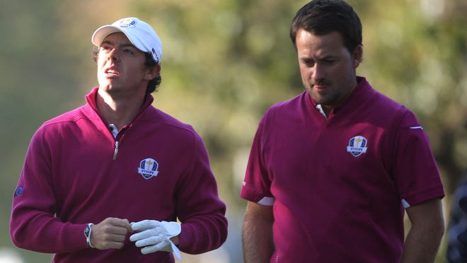 McIlroy walks with Graeme McDowell during the 2012 Ryder Cup at Medinah Country Club.