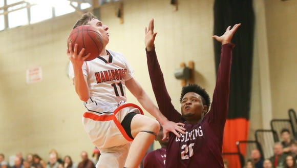 Mamaroneck's James Manetta (11) drives on Ossining's