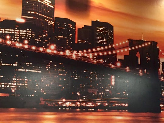 A large image of the Brooklyn Bridge covers one wall of Toni Rigatonis. Owner Chris Schiavone's family originally is from Brooklyn.