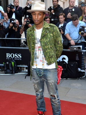 Pharrell Williams attends the GQ Men of the Year Awards on Sept. 2, 2014, in London.