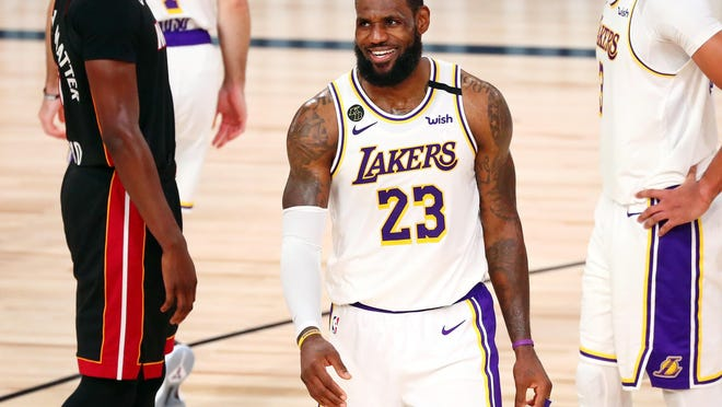 Los Angeles Lakers forward LeBron James (23) smiles after a play against the Miami Heat during the fourth quarter of Game 6 of the 2020 NBA Finals.