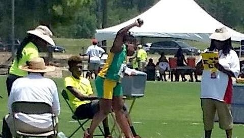 Shown is Ayanna Hunt throwing her winning shot put personal best throw of 27 feet, 4 inches, winning the gold at the AAU Junior Olympics in Houston, Texas.