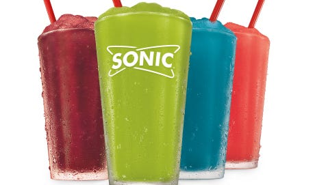 Sonic Drive-In debuts four new summertime frozen slushes June 11 including its bright green Pickle Juice Slush.