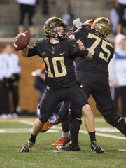 Oct 8, 2016; Winston-Salem, NC, USA;  Wake Forest Demon Deacons quarterback John Wolford (10) passes the ball during the third quarter against the Syracuse Orange at BB&T Field. Wake defeated Syracuse 28-9. Mandatory Credit: Jeremy Brevard-USA TODAY Sports