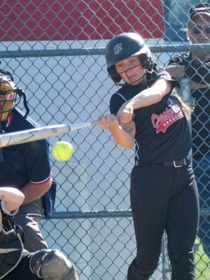Crestview Lady Cougar Kennedy Hickey rips a base hit in the sixth inning of Crestview's 4-0 win over Monroeville on Monday.