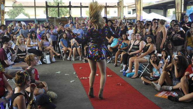 People clapped, danced, cheered and handed dollar bills to beautifully dressed drag performers, who did not shed a single drop of sweat, during The Source LGBT+ Center's first annual Pride Visalia.  More than 2,000 people joined the celebration on Saturday at Visalia's Old Lumber Yard.