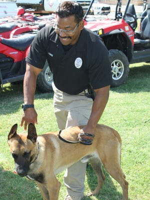 Carlsbad Police Officer Norman Bowie and K-9 Alf finish their demonstration, July 4 at Lake Carlsbad Beach Park.