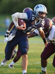 John Jay's Ryan Schumacher runs the ball during Friday's home game versus Arlington.