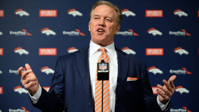 Jan 20, 2015; Englewood, CO, USA; Denver Broncos executive vice president of football operations/general manager John Elway speaks to the media at the Broncos training facility.