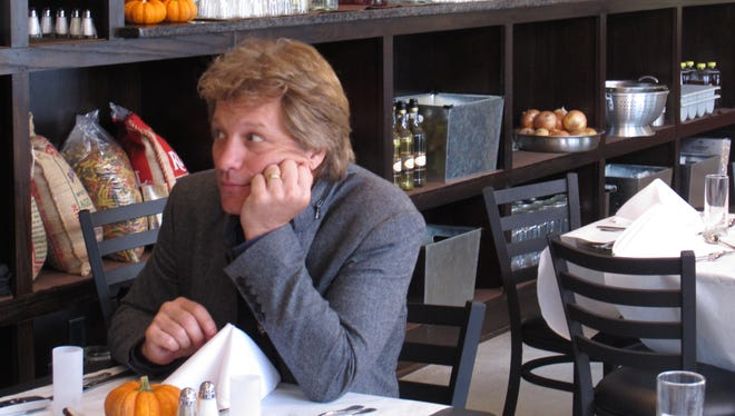 Jon Bon Jovi sits in his JBJ Soul Kitchen community restaurant in Red Bank, N.J. which lets the needy do community service in return for a hot meal.