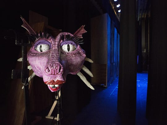 The head of Dragon sits backstage during a dress rehearsal .