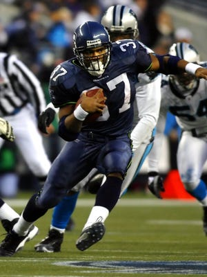 Seattle Seahawks' Shaun Alexander, here rushing against the Carolina Panthers, will be in Pensacola on March 18 as the guest speaker at the 61st annual Pensacola Sports Association Awards Banquet. The event will be at Sanders Beach Community Center.