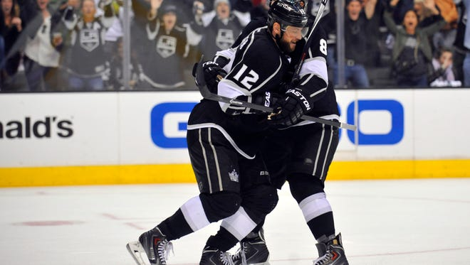 Former Ranger Marian Gaborik (12) is embraced by Kings teammate Drew Doughty after scoring a goal against the Rangers on Saturday night.