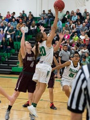 Fallon junior Leilani Otuafi shoots against Dayton