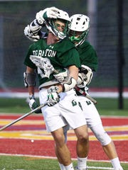 Delbarton sophomore Jack Cerza is embraced by senior