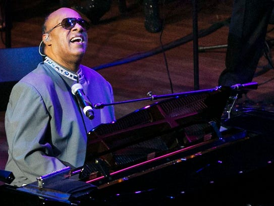 Music legend Stevie Wonder performs one of his hit
