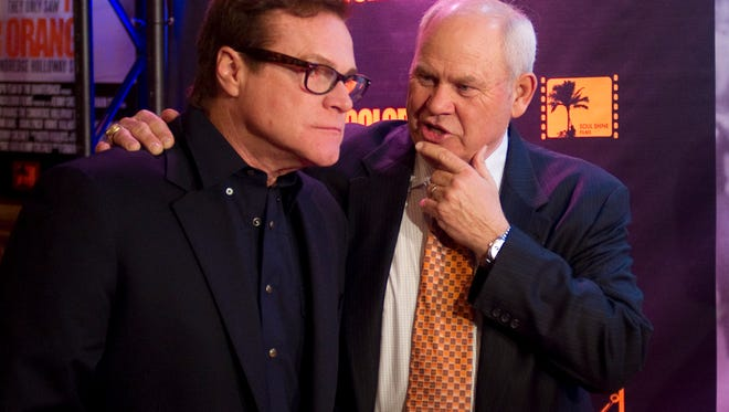 "Former Tennessee football coach Phillip Fulmer, right, chats with actor David Keith during the premier of ""The Color Orange: The Condredge Holloway Story"" at the Tennessee Theatre on Feb. 16, 2011."