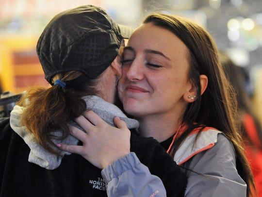 Vineland High School sophomore Cassidy Campanella hugs