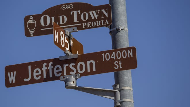 Street signs in Old Town Peoria are pictured on May 16, 2018.