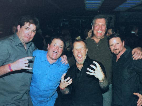 "Metallica vocalist-guitarist James Hetfield, center, is pictured with Old Bridge Militia members, from left, John Marshall ""Stack,"" ""Metal"" Joe Chimienti, Dave ""Reb"" Snyder, and ""Rockin'"" Ray Dill at the House of Blues in Cleveland the night before the pioneering thrash metal band's 2009 induction into the Rock and Roll Hall of Fame. Both Marshall and Schneider had been roadies for Metallica, and the band lived with Chimienti and Dill in 1983 and 1984 in Farmingdale and Old Bridge."