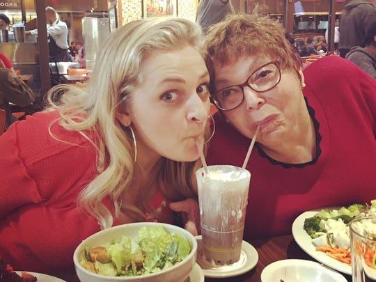 """Actress Ali Stroker and disabled rights advocate Judy Heumann share a chocolate milkshake in Junior's delicatessen. Stroker portrayed Heumann in an episode of """"Drunk History."""""""