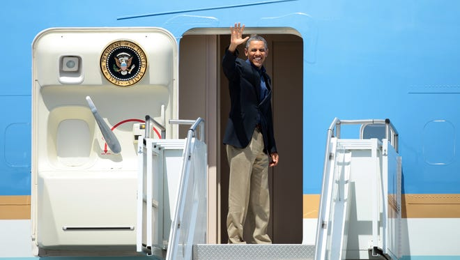 FILE - President Barack Obama waves from the doorway of Air Force One at Palm Springs International Airport on Sunday, June 9, 2013 to leave Southern California following a weekend summit at Sunnylands with President Xi Jinping of China.