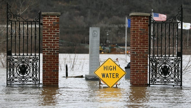 Flood waters close Bellevue Beach Park, Sunday, Feb. 25, 2018, in Bellevue, Ky. The Ohio River is expected to crest at 60.7 feet by Sunday evening, according to the National Weather Service. The river rose above the 60 feet mark for the first time in two decades Sunday morning.