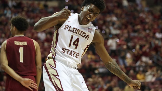 FSU's Terance Mann pumps his fist in celebration after dishing off an assist to Trent Forrest for the score against Boston College's during their game at the Tucker Civic Center on Saturday, March 3, 2018.