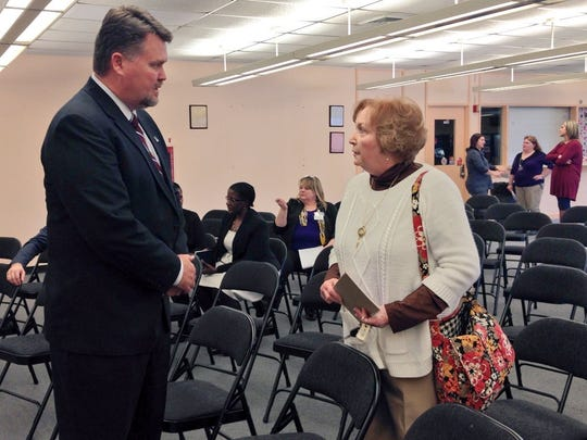 Monty Sullivan, president of the Louisiana Community and Technical College System, speaks with Anita Kerry, coordinator of adult education at Central Louisiana Technical Community College in Alexandria, Wednesday after addressing faculty and staff from seven CLTCC campuses.