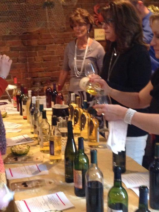 -pix-wine tasting 2013 pourers at wine table.JPG_20141112.jpg