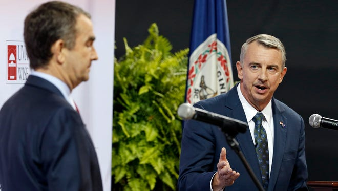 In this Oct. 9, 2017, file photo, Republican gubernatorial candidate Ed Gillespie, right, speaks at a debate with Democratic challenger Ralph Northam in Wise, Va. The contest between Gillespie and Northam could be an early referendum on President Trump's political popularity ahead of the 2018 midterm elections.