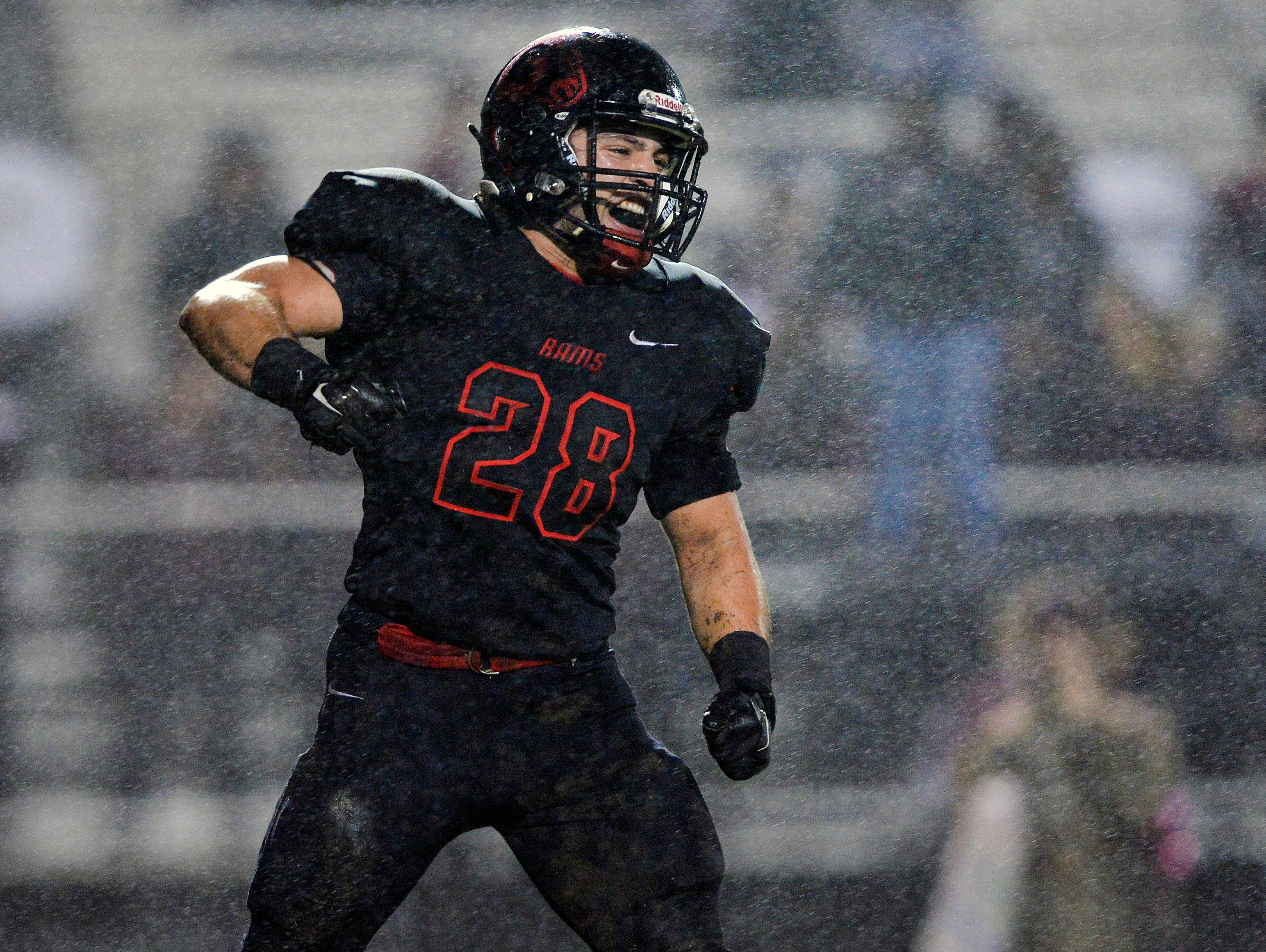Hillcrest's Isaiah Sayegh (28) celebrates after sacking Westside quarterback Jackson Williamson (5) in a Region 1-AAAA game at Hillcrest High School on Friday, October 2, 2015.