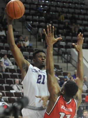 ACU's Jalone Friday, left, shoots over Lamar's Josh Nzeakor in the second half. The Wildcats beat Lamar 74-69 in the Southland Conference men's basketball game Wednesday, Jan. 31, 2018 at Moody Coliseum.