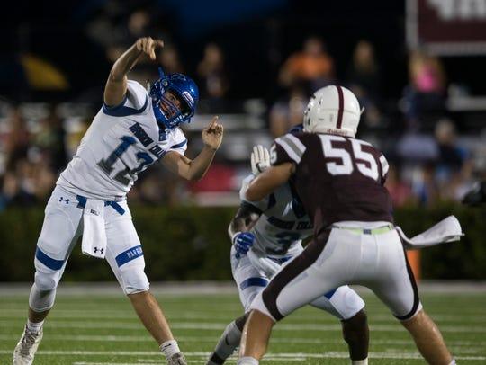 Barron Collier quarterback Jacob Kuhlman (12) throws