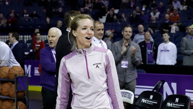 LPGA Tour player Kris Tamulis, a Naples High School graduate, reacts after missing her putt in the halftime event during an NCAA college basketball game between Wisconsin and Northwestern on Thursday,  Feb. 22, 2018, in Rosemont, Ill. The event was to promote the KPMG Women's PGA Championship, which will be played in the Chicago area this summer. Tamulis was putting for everyone in attendance to win a ticket to the tournament.
