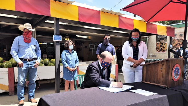 Gov. Jares Polis visits Pueblo and Southern Colorado to sign various bills into law.