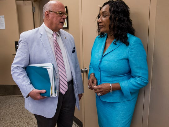 Ann Moore, right, chats with Montgomery School Board