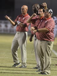 Parkway head coach David Feaster talks with his coaches