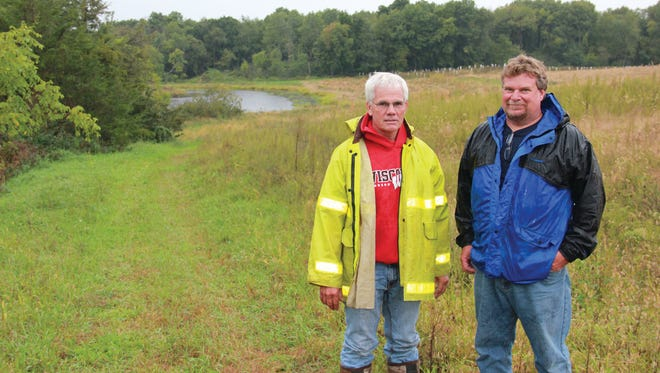 Ohne Raasch, of Lake Mills, WI (left) and Mark Steinfest, Elkhorn Area Civil Engineering Technician, U.S. Department of Agriculture, Natural Resources Conservation Service (NRCS), view the restored easement on the Raasch property.