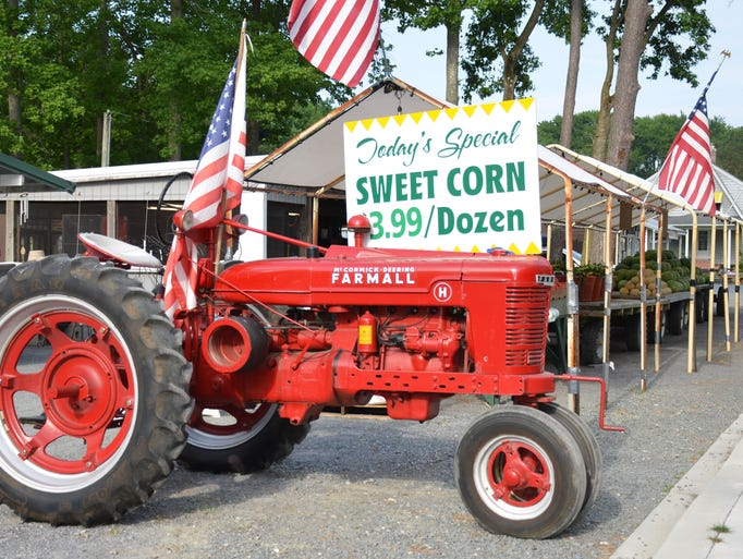 1950s era Farmall tractor at a produce stand in Ocean