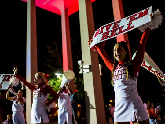 UL students cheer during the Yell Like Hell homecoming
