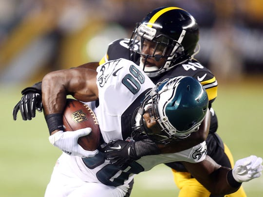 Aug 18, 2016; Pittsburgh, PA, USA;  Philadelphia Eagles wide receiver Paul Turner (80) runs after a catch as Pittsburgh Steelers defensive back Montell Garner (40) defends during the second quarter at Heinz Field.