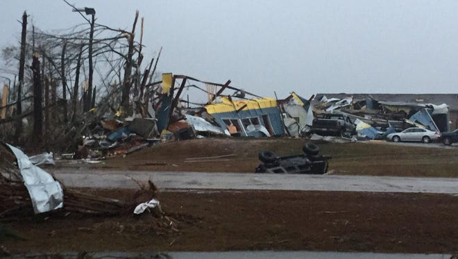 A building on U.S. 98 in Columbia and some vehicles are destroyed after a tornado ripped through Marion County.