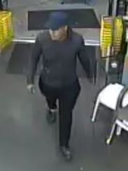 Surveillance video showing a man suspected in a robbery