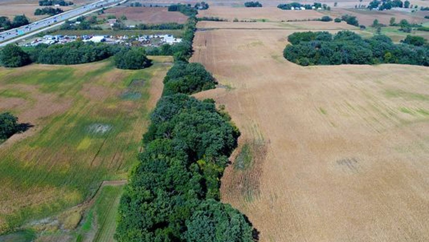 Mount Pleasant begins buying farmland optioned for Foxconn at about $50,000 an acre