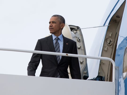 President Obama boards Air Force One at Andrews Air
