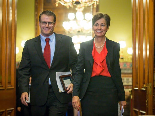 Iowa Gov. Kim Reynolds, right, enters the governor's formal office  on Thursday, May 25, 2017, with Adam Gregg, the state's public defender, after appointing him acting lieutenant governor.