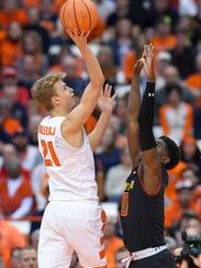 Syracuse Orange forward Marek Dolezaj (21) shoots the