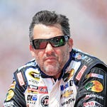 In this July 12, 2013 file photo, NASCAR driver Tony Stewart speaks at a press conference prior to NASCAR practice at the New Hampshire Motor Speedway in Loudon, N.H.