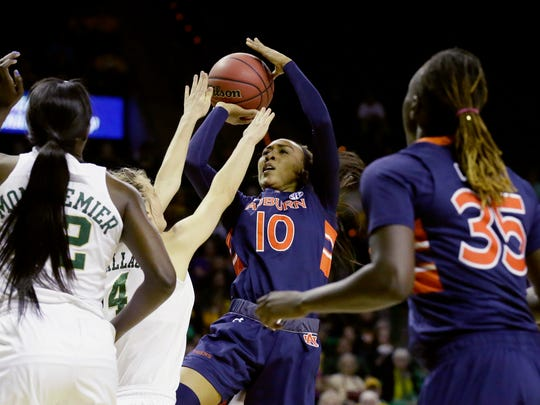 Auburn guard Brandy Montgomery (10) shoots against Baylor guard Kristy Wallace (4) and Baylor center Beatrice Mompremier (32) and Auburn forward Cabriana Capers (35) look on during the first half of a second-round women's college basketball game in the NCAA Tournament Sunday, March 20, 2016, in Waco, Texas. (AP Photo/LM Otero)